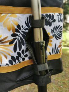 Arany-fekete leveles rolleres táska